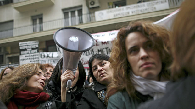 State-employed doctors protest outside the Greek  health ministry in Athens, on Thursday. A European Union official says  international debt inspectors have found Athens has reached the limit of  what can be achieved by budgetary spending cuts.  (Petros  Giannakouris/Associated Press)