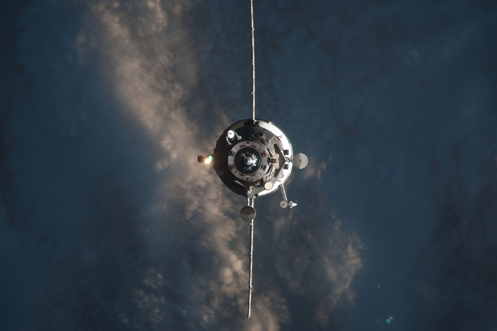 An unmanned Progress resupply vehicle approaches the International Space Station.
