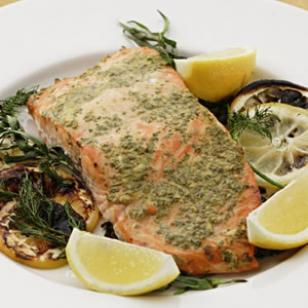 LETS EAT HEALTHY…..GRilled Salmon With mustard and herbs.  INGREDIENTS 2 lemons, thinly sliced, plus 1 lemon cut into wedges for garnish 20-30 sprigs mixed fresh herbs, plus 2 tablespoons chopped, divided 1 clove garlic 1/4 teaspoon salt 1 tablespoon Dijon mustard 1 pound center-cut salmon, skinned  PREPARATION Preheat grill to medium-high. Lay two 9-inch pieces of heavy-duty foil on top of each other and place on a rimless baking sheet. Arrange lemon slices in two layers in the center of the foil. Spread herb sprigs over the lemons. With the side of a chef's knife, mash garlic with salt to form a paste. Transfer to a small dish and stir in mustard and the remaining 2 tablespoons chopped herbs. Spread the mixture over both sides of the salmon. Place the salmon on the herb sprigs. Slide the foil and salmon off the baking sheet onto the grill without disturbing the salmon-lemon stack. Cover the grill; cook until the salmon is opaque in the center, 18 to 24 minutes. Wearing oven mitts, carefully transfer foil and salmon back onto the baking sheet. Cut the salmon into 4 portions and serve with lemon wedges (discard herb sprigs and lemon slices).