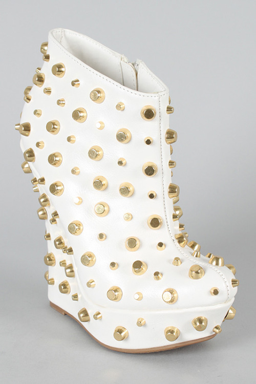 White leather. Gold industrial style grommettes. Chunky platform. Get 'em while they're hot at Glam Fashion Boutique.
