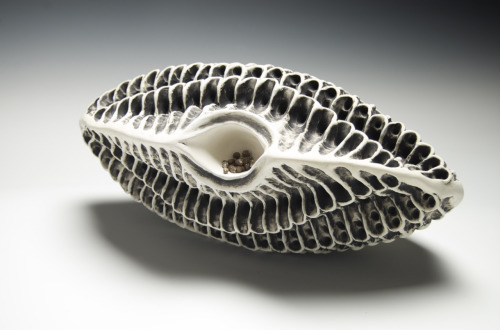 Debra Fleury: Bone, 2010. White Stoneware, Dark Stoneware and underglaze. Fired to cone 1 (neutral atmosphere). Dimensions 41 cm x 29 cm x 29 cm