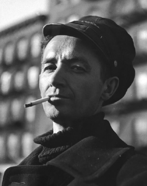 "I love Woody! life:  The one, the only… Woody Guthrie. In 1943, the modern-day troubadour and national treasure, Woodrow Wilson  ""Woody"" Guthrie, was about to publish his now-classic,  semi-fictionalized autobiography, Bound for Glory, in which he  wrote vibrantly about his childhood, his love of American folk songs,  and his epic travels as a freight car-hopping hobo. On assignment for LIFE in 1943, photographer Eric Schaal followed  Guthrie as he gave impromptu performances around New York — in bars, on  the stoops of brownstones, on the subway. Engaging, charming, and at  ease, the Woody Guthrie in these photos is exactly where he most liked  to be: among the people, guitar in hand."
