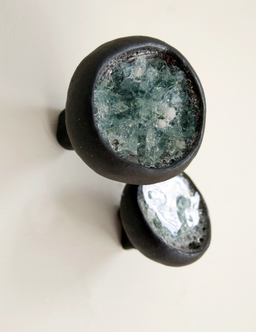 Debra Fleury: Ice, 2011. Dark Stoneware, Porcelain and glass. Fired to cone 6 (neutral atmosphere), (wall installation). Dimensions variable, average size per individual piece is approximately 5 cm x 5 cm x  7 cm