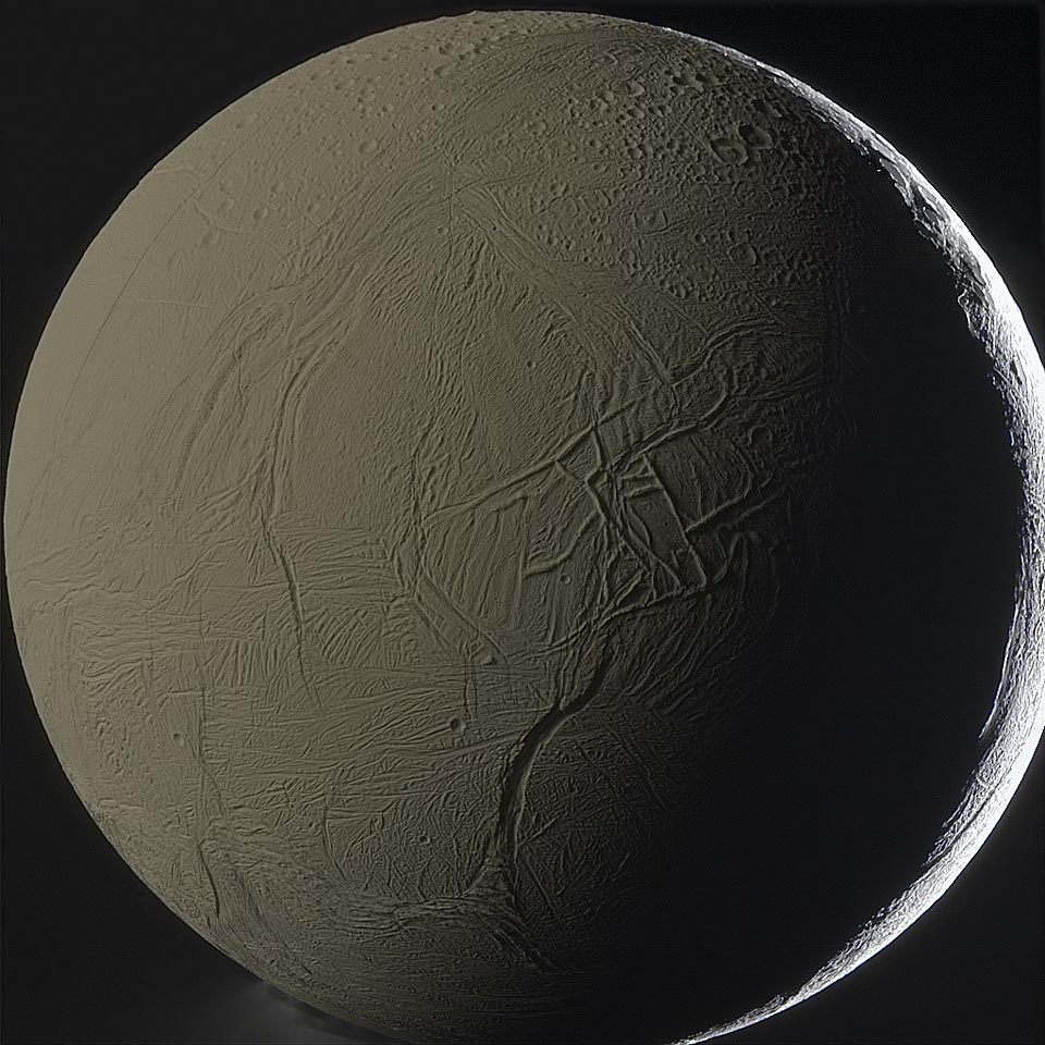 ikenbot:  Enceladus Backlit by Saturn Image Credit: Cassini Imaging Team, SSI, JPL, ESA, NASA; Color Composite: Gordan Ugarkovic This moon is shining by the light of its planet. Specifically, a large portion of Enceladus pictured above is illuminated primarily by sunlight first reflected from the planet Saturn. The result is that the normally snow-white moon appears in the gold color of Saturn's cloud tops. As most of the illumination comes from the image left, a labyrinth of ridges throws notable shadows just to the right of the image center, while the kilometer-deep canyon Labtayt Sulci is visible just below. The bright thin crescent on the far right is the only part of Enceladus directly lit by the Sun. The above image was taken last year by the robotic Cassini spacecraft during a close pass by by the enigmatic moon. Inspection of the lower part of this digitally sharpened image reveals plumes of ice crystals thought to originate in a below-surface sea.