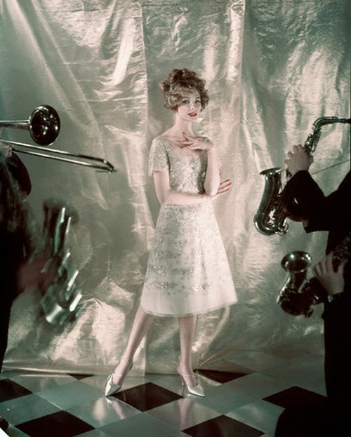 theniftyfifties:  Model wearing a tulle and gold embroidered trapeze dress by Dior, 1958. Photo by Henry Clarke.