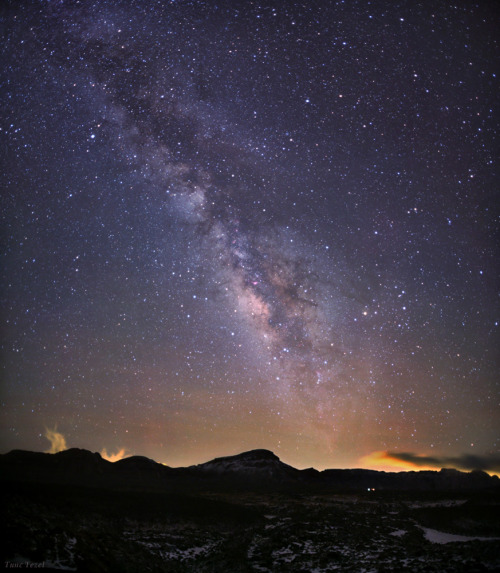 ikenbot:  Galactic View from Canary Islands by Tunc Tezel The band of our home galaxy, the Milky Way, is photographed above mountains of Tenerife, Canary Islands.