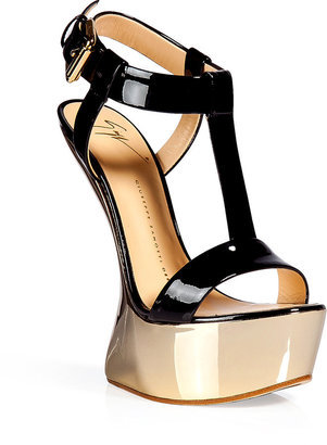 dangerouslydeliciious:  Guiseppe Zanotti black and gold platform sandal