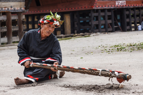 Batak Shaman on Flickr.Via Flickr: The magic pole the old man is wielding is used to smash an egg to bits, lying on the ground before him. Another scene from a Traditional Batak dance performance ( Tor-tor and Sigale-gale) at the Huta Bolon Village (Desa Huta Bolon), Simanindo, Samosir Island, North Sumatra. There are eleven parts to the performance altogether, e.g. a ceremony for the gods, the sacrifice of a buffalo, a dance of women hoping to find a husband. At about 'half time', spectators are invited to join the dancers. Location: Samosir Island, North Sumatra, Indonesiaartflakes • google+ • twitter • facebook •  tumblr  •  500px •  blog All Rights Reserved, no reproduction without prior permission. © Alexander Ipfelkofer