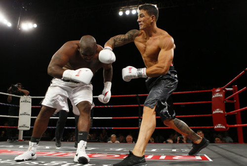 Sonny Bill Williams lands a punch on Clarence Tillman III.