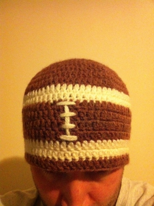My first attempt at an American football hat.  To be honest the hardest thing about it was finding the right colour wool!  If I make one again I think I will make the white stripes a bit thinner - but enjoyed the challenge.
