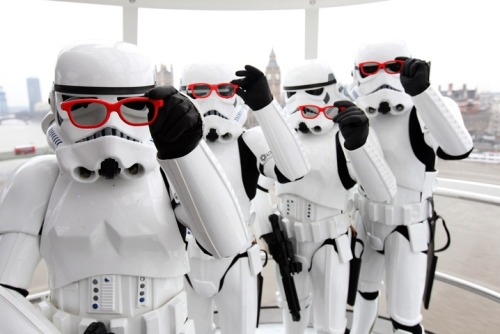 "newshour:  Stormtroopers in London promote Friday's release of ""Star Wars Episode 1: The Phantom Menace 3D""  (Photo by Dave J. Hogan/Getty Images)"