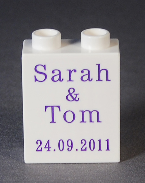 This is another wedding favor that we did for Sarah and Tom in the UK! Tom actually works for LEGO so his wedding definitely needed some LEGO flair. :) Their wedding colors were purple and white so we engraved their name and the date on a white Duplo in purple text.