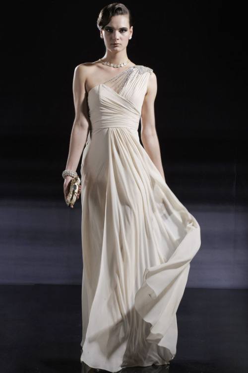 Cream Single Strap Wedding Dress With Embellishments £195.00  Classic floor length wedding dress in soft cream tone featuring single strap A Line silhouette, drape on skirt, semi ruched side waistline and lace embellished strap with beads and crystals.
