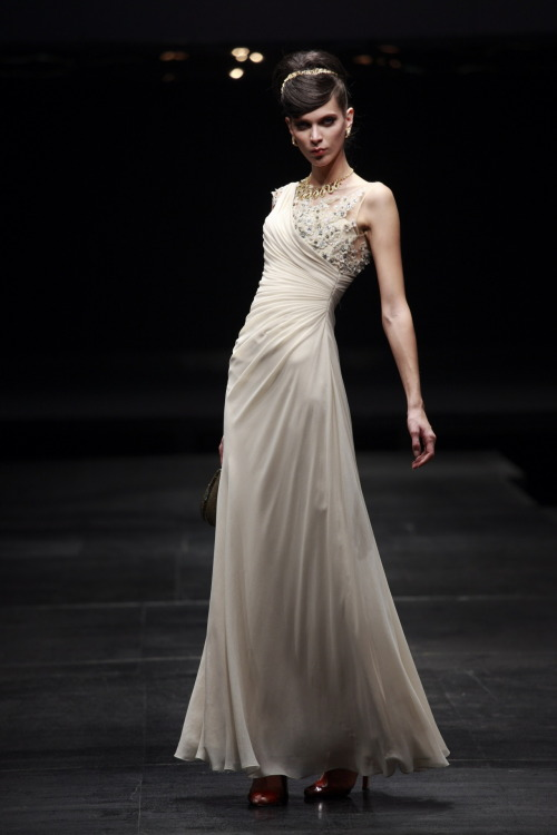 Cream Chiffon Wedding Dress With Floral Embellishments £195.00  Elegant wedding dress in light cream colour featuring sleeveless floor length A Line silhouette with chiffon full overlay, rough pleats on bodice, and embroidered flower embellishments on lace bodice and upper back. Send us a message to inquire about our plus size or if you like this dress in another colour of your choice.