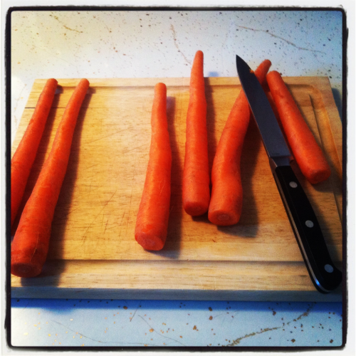 Carrots and cutting board. Getting ready to make winter vegetable minestrone. Photo has an Instagram filter.