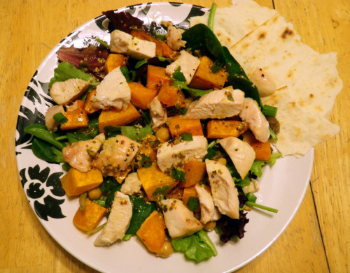 Butternut Squash, Chicken, and Chickpea Salad (Recipe by Marina) Serves 2 Ingredients: 2 boneless chicken breasts 1 can chickpeas Lettuce or field greens Sunflower seeds (Salted or unsalted, depending on preference) 1 1/2 lbs butternut squash 1/2 teaspoon dried thyme 1/2 teaspoon dried oregano 1 large lemon Olive oil 1 teaspoon course dijon mustard Salt and pepper Dried chili flakes Lemon zest Chives or green onions To Make: Preheat oven to 425 Peel and chop butternut squash into 1 inch cubes Cut the chicken breasts into 2 inch morsels On two seperate baking sheets, arrange butternut squash on one and chicken on the other. Season each with salt and pepper. Season butternut squash with a sprinkle of thyme.  Coat squash and chicken with 2 tablespoons of olive oil and, using hands, toss gently until everything is coated evenly. Pop in the oven for 20-27 minutes. The chicken will take less time to cook than the squash so check on it around 20 minutes.  Meanwhile, in a large salad bowl, arrange lettuce Sprinkle in 2 tablespoons sunflower seeds Toss in 4 tablespoons of chickpeas In a small bowl, mix together 1 tablespoon olive oil, the juice of 1 lemon, the zest of same lemon, 1 teaspoon course dijon mustard, 1/2 teaspoon dried oregano, 1/2 teaspoon dried thyme, and a dash of dried chili flakes to taste. Whisk it all together until a nice dressing is formed.  When chicken and squash are done, arrange in salad. Drizzle the dressing over the salad and top with some chopped chives or green onions.  Enjoy! I'm addicted to this salad! So good and so filling.