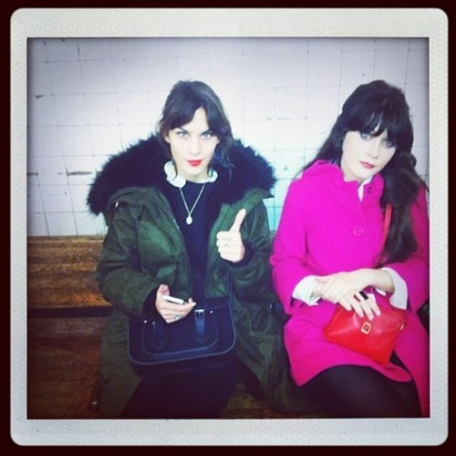 Zooey Deschanel & Alexa Chung waitin' for a train.