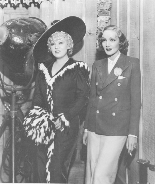 Mae West and Marlene Dietrich, two of film's sexiest screen sirens, photographed on the set of She Done Him Wrong (1933).