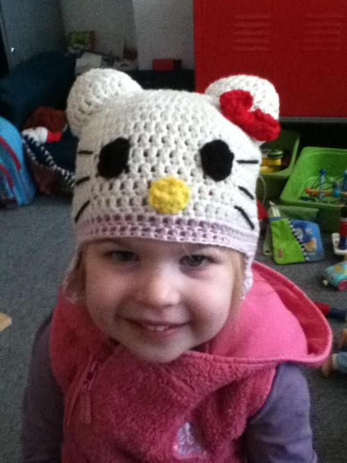 Hello Kitty!  A very easy hat to make, although I had to learn a new skill to make the bow, which was highly simple. ch5 slip stitch into end to make a circle. Ch 5, 5 tr in ring, ch 5, slip stitch in ring, ch 5, 5tr in ring, ch5, slip stitch in ring. rap yarn around the middle to make bow.   enjoy.