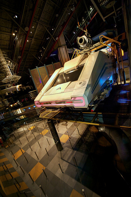 "Starspeeder Space Hangar on Flickr.Tomorrowland Tokyo Disneyland This week: The Tokyo of Tomorrow(land) As I've mentioned before, Star Tours is a big feature of Tokyo Disneyland's Tomorrowland. Opened 1989, I'm assuming the design was finalized when the then-new Star Tours was at the height of its popularity in California and the Tokyo design was adjusted to treat this as a huge E-ticket with space for the accompanying crowds. While the Tokyo version of the ride itself is identical to the other versions, everything else about it just seems to have a grander scope, beyond the usual Tokyo-plussing. For example, the queue features an additional room before the familiar C3PO-droid room-loading room set-up: the huge hangar area pictured here. While only a single room, it has a scale and grandeur not showcased in other versions of this attraction, really helping to drive home that you are in some sort of space hangar. The queue also features many more random droids and animtronic figures, feeling more lively and ""lived-in"" than any other version I've been to. When I was visiting, Tokyo's Star Tours was still operating as the original version and not the revamped version that recently opened in California and Florida. It was cool to see the original one last time and to hear Rex speaking Japanese. Tokyo Disneyland is currently in the process of converting the ride to the newer version. I know this gets said fairly often about Tokyo's attractions, but it's especially true here: Tokyo Disneyland's Star Tours is the definitive version of the attraction, without question. It will never impress or delight you more than it will in Tokyo. Twitter: photojames Instagram: jdhilger"