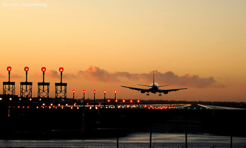 foreverflyhigh:  Airplane landing at Schiphol by Karsten Groeneweg on Flickr.