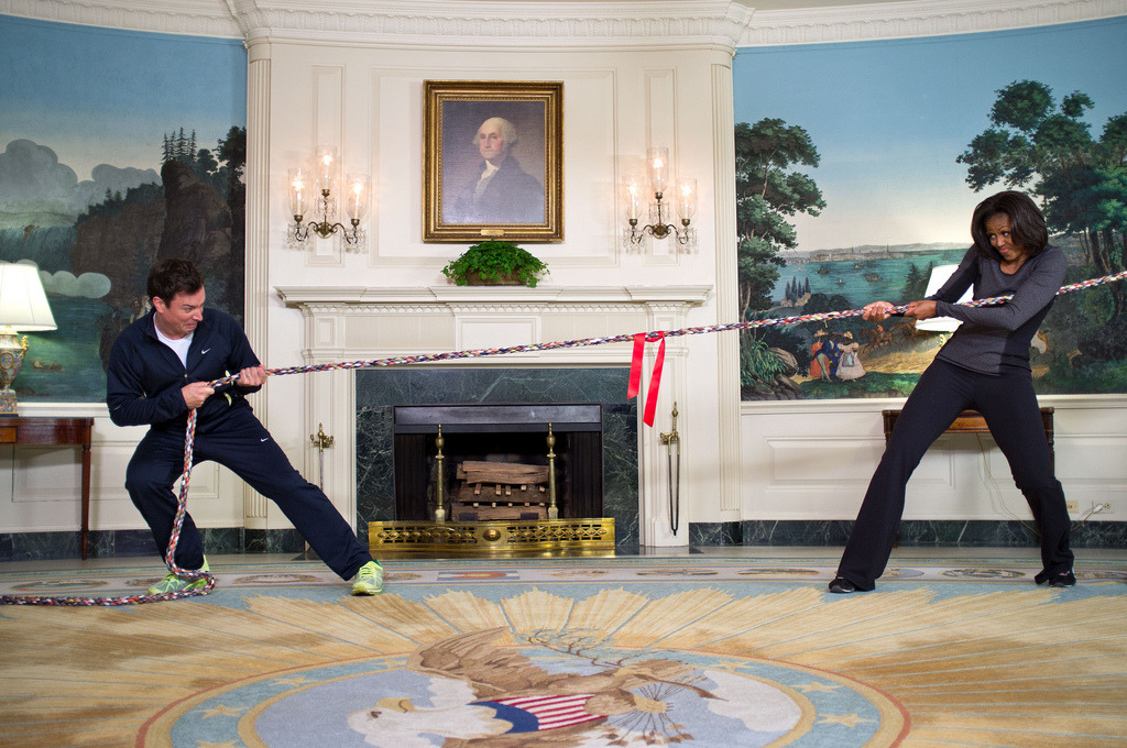 "Image description: First Lady Michelle Obama participates in a tug of war with Jimmy Fallon during a taping of ""Late Night with Jimmy Fallon"" on January 25. The First Lady was on the show to recognize the second anniversary the ""Let's Move!"" initiative. Photo by Chuck Kennedy, White House"