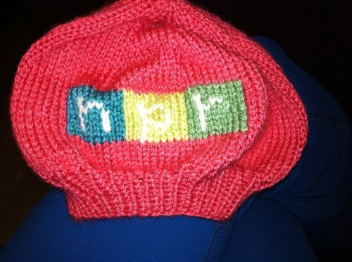 ncpr:  NPR Knitters Unite!  nprdigitalsvcs: Do you love NPR? Sure you do! But do you love it enough to knit a baby beret, like our own Erin Martin recently did for coworker Dan Sundell's new baby daughter? Or enough to tattoo our logo somewhere on your body? Or how about enough to hold up a card proclaiming your love? Then show us how you heart NPR! There could be some swag (or is it schwag?) in it for you. NOTE: Looking like the Clooney is not required.