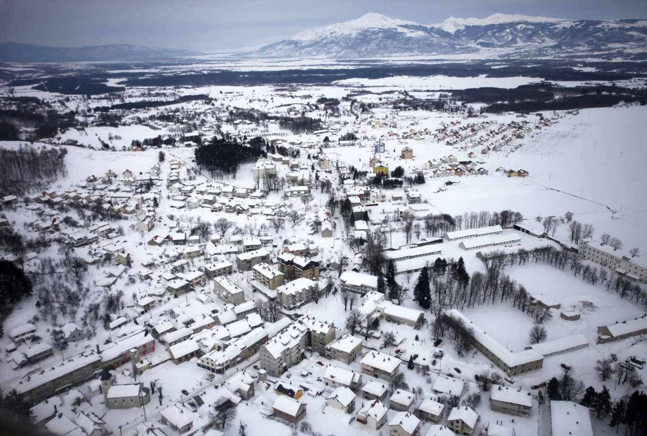 reuters:  An aerial view of the isolated city of Nevesinje, which has gone without water and electricity for the past five days after power lines and infrastructure were damaged by heavy snowfall in eastern Bosnia, February 9, 2012. Europe's bitterly cold weather killed another 33 people on Monday, with Bosnia recording its eighth victim after an 87-year-old woman died of hypothermia. [REUTERS/Dado Ruvic]