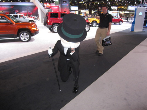 The Monopoly Man at the 2012 Chicago Auto Show… Tebowing.
