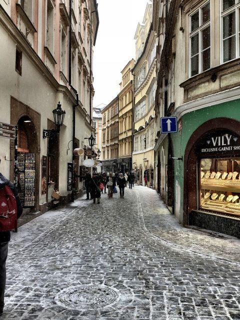 | ♕ |  {photo of the day}  Prague  | by/via © buhbuhbilly  A wonderful wanderer's photo.Look at the snow on the cobblestone… how cold today!