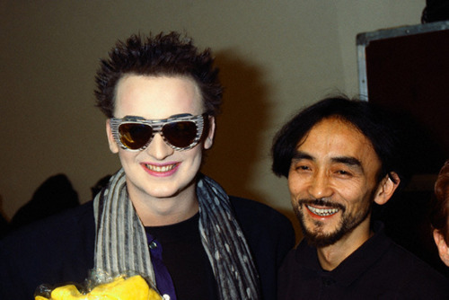 boy george and yohji yamamoto backstage at his fall/winter 1985 show