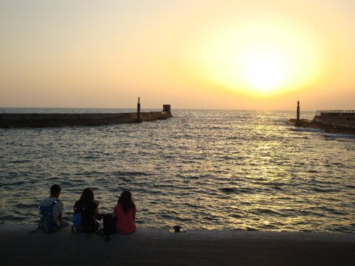 "Israel Photo of the Day- ""Sunset on CVK"" (Ayala Lesser, 2010) ""This picture displays one of the many amazing moments on CVK. We got to experience Israel, many for the first time, in a wonderful way. Here 3 of my friends sit and watch the breathtaking sunset in Tel Aviv.This picture is just a taste of the incredible experience!"""