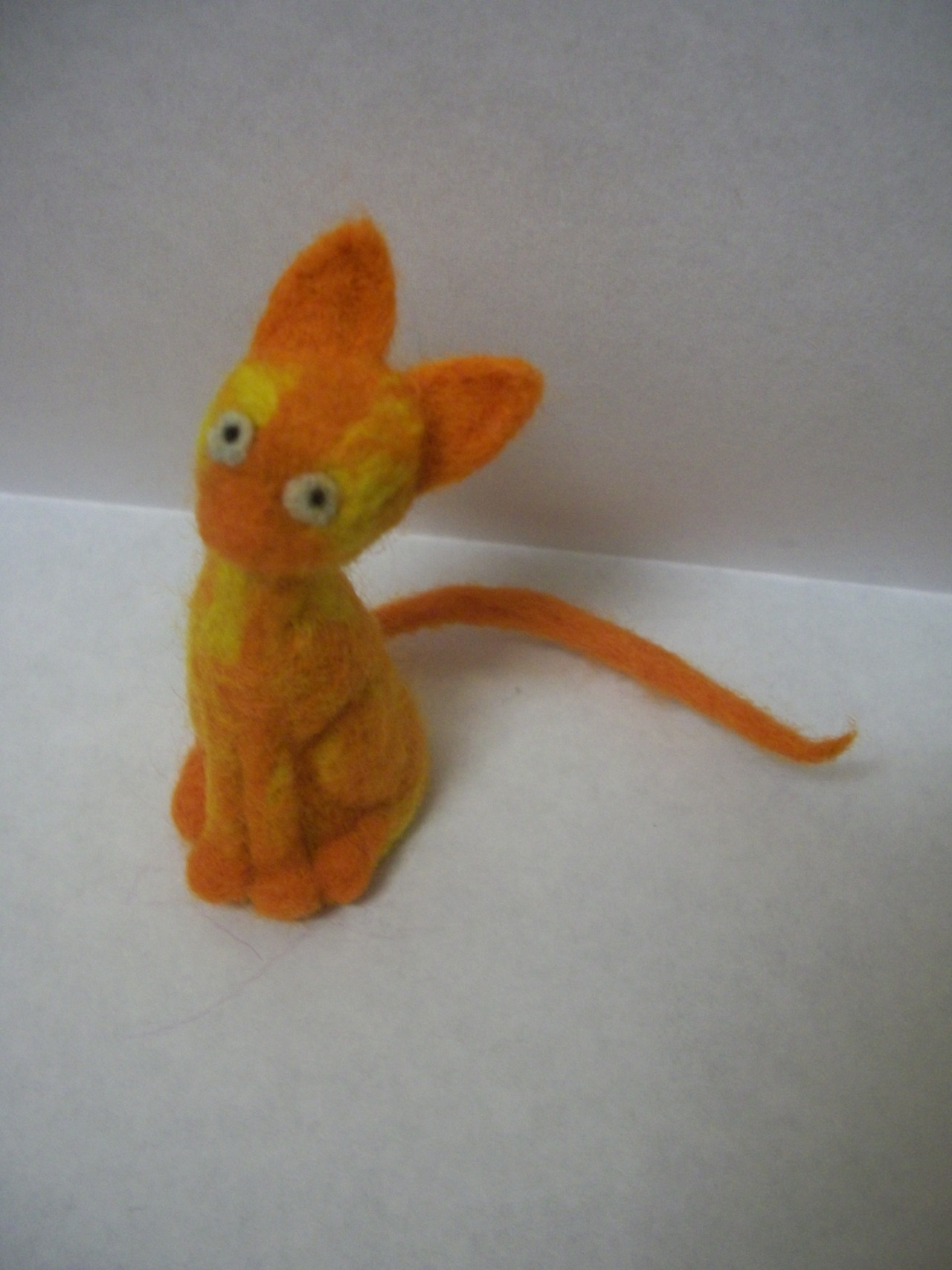 So this is my first foray into the world of needle felting and my god! Is it hard! It looks relatively simple but it is insanely labour intensive and I'm pretty certain I'm getting rsi already. Even so I am mega proud of my little cat heh.