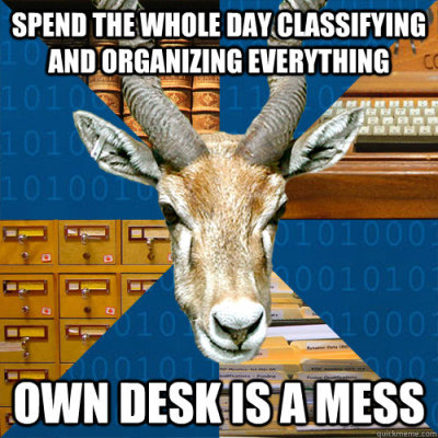 "informationscienceantelope:  [Spend the whole day classifying and organizing everything, own desk is a mess]  To my ""organization freak"" cred, it's an organized mess.  My mess isn't organized… Library school. No time to clean the things."