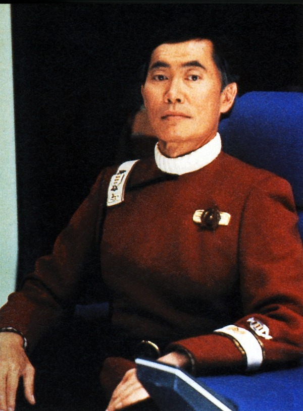 "Captain Hikaru Sulu, U.S.S. Excelsior. Little known factoid: Sulu's promotion to Captain of Excelsior was originally written for ""Star Trek II: The Wrath of Khan"" before ever seeing said ship.  The scene was even shot - but according to George Takei's autobiography, Bill Shatner kept giving an even worse-than-normal (or acceptable) performance of said scene.  To that end, it eventually was simply scrapped due to time and budget. Some might say, ""oh, it's just old colleagues being bitter"" when they hear of such nonsense on Shatner's part.  But if you've ever met him, you find it much more believable.  He's funny on stage or on camera, but absent said spot-light, he's a prima dona all the way. ((Like This?  Check Out My Archive and Follow Me!))"