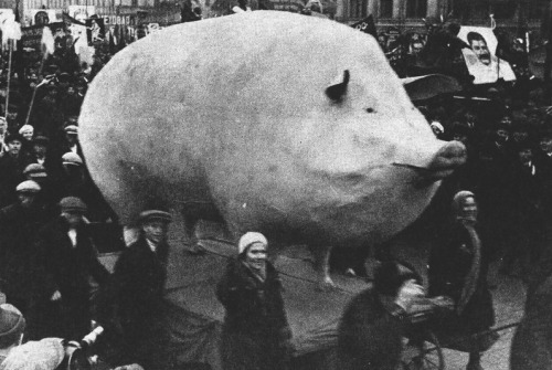 zolotoivek:  Soviet demonstration with a large sculpture of a pig, 1920-30's.