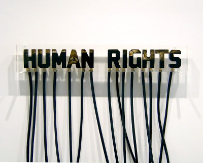 """human rights"" by andrei molodkin  By transforming oil from an organic resource into an aesthetic form, the artist raises important questions regarding the role of oil within our contemporary Western culture. He explores the clash between culture, religion, economy and politics when he uses recognizable religious images or cultural iconography as his subject matter. Molodkin believes that the oil industry is the flesh and blood of Western economy and he comments on how a national resource can become a national identity. (wikipedia)"