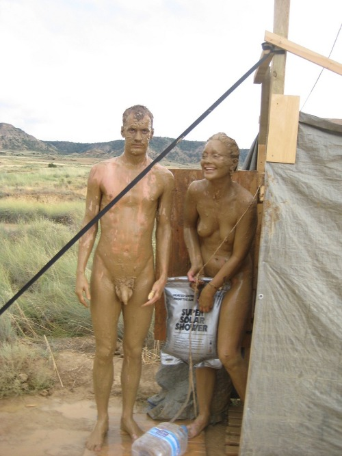 lovetobate:naktivated:just-natural-nudist:washing the muddy off …That solar shower is going to need a refill.Muddy man,yum