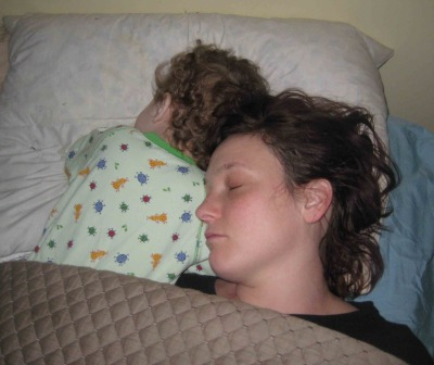 This is how I sleep (when she will let me). Notice how much of my pillow I have?