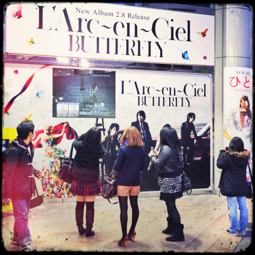 tokyo-fashion:  Japanese girls taking pics of L'Arc-en-Ciel billboards outside of Tower Records Shibuya today.  AAAAAAA !!!