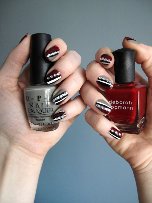 Fancy Nails!! Deborah Lippmann - Lady Is A Tramp OPI - Suzi Takes The Wheel Matesse Elite Nail Art Paint - Black Matesse Elite Nail Art Paint - White Small rhinestones OPI - RapiDry Top Coat 1. Apply one coat of Suzi Takes The Wheel to the nails and allow to dry. 2. Apply Lady Is A Tramp diagonally across half of the nail bed and allow to dry. 3. Apply stripes of white Nail Art Paint to various parts of the nail bed. 4. Apply stripes of black Nail Art Paint next to or on either side of the white stripes.  Do something different on each nail. 5. Using a pointed tweezer apply four or five rhinestones in a diagonal line over each nail. 6. Apply OPI topcoat.