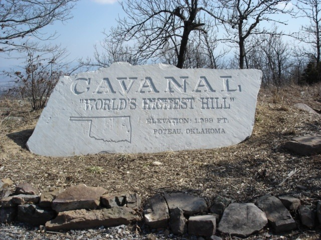 "Cavanal Hill, Poteau, Oklahoma  DSC03709 by okroads on Flickr  Cavanal ""World's Highest Hill"" monument at the top of the hill. It is called the world's highest hill because technically, a mountain has an elevation of 2,000 feet and higher, and Cavanal is 1,999 feet tall.  Cavanal Hill (officially Cavanal Mountain according to the US Geological Survey) located at Poteau, Oklahoma is billed as the tallest hill in the world at 1,999 feet (609 meters), based on the idea that it would be classified as a mountain if it were 2,000 feet or higher.  Located West on Witteville Dr., Poteau, Oklahoma  Place: http://blogoklahoma.us/place.asp?id=552 Map: http://g.co/maps/sgzqe Wikipeida: http://en.wikipedia.org/wiki/Cavanal_Hill"