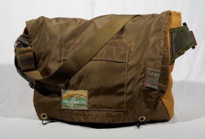 Custom messenger bags made from salvaged military gear.
