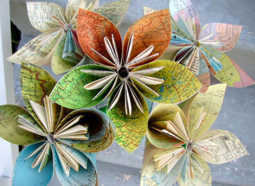 DIY paper flowers from old maps. This reminds us of this recycled paper flower wedding bouquet that we posted a while back - bit.ly/rsnP0l (via DIY Paper Flowers From Recycled Maps | Apartment Therapy)