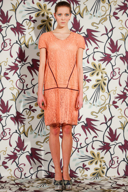 Mirrored platforms and coral colored lace dresses are as pretty as a picture at NAHM. We're also inspired to wallpaper our walls with Dr. Seuss florals! #NYFW