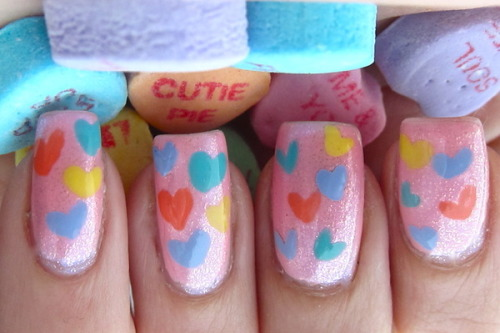 Beautylish Brooke S. creates an adorable and easy conversation hearts manicure - watch her nail tutorial to achieve this look!