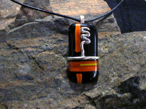 Orange and black glass pendant: fused glass rods with a solid silver accent. http://www.etsy.com/listing/92705979/orange-and-black-glass-pendant-with