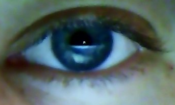 Took a picture of my eye and I can swear I can make out the Earth with the moon above in my pupil.