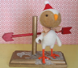 allgoodwishes:  which way to love? needle felted bird on a vintage base.