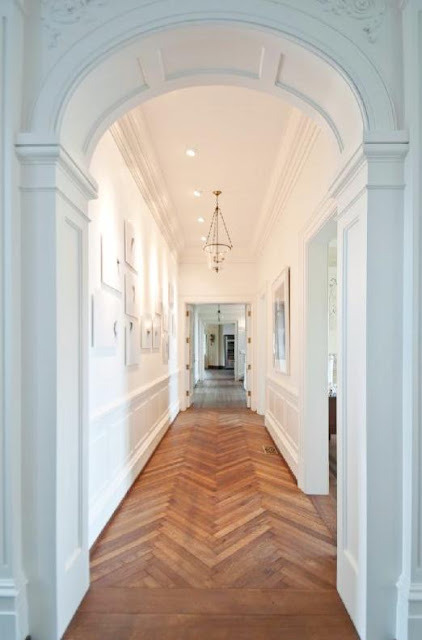 Herringbone wood floors with opulent entryways